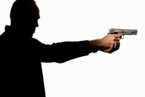 man_holding_gun